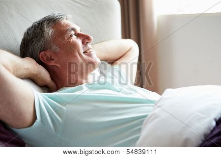 Middle Aged Man Waking Up In Bed