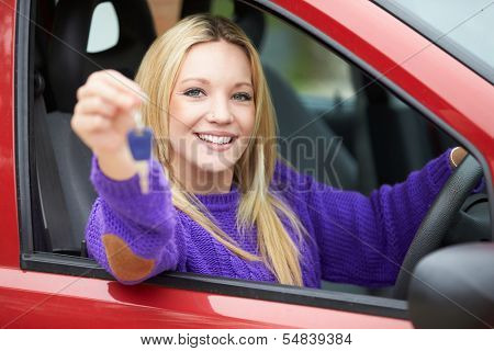 Teenage Girl Standing Next To Car Holding Key