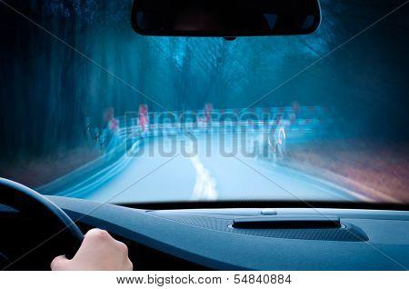 caution - curvy road at night