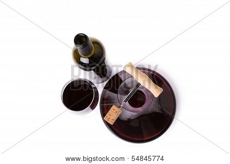 Decanter bottle and glass with red wine top view.