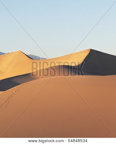 The well-known Death Valley in California. Sandy barkhans accurately also are effectively shined by a rising sun