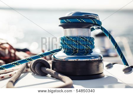 Closeup on yacht cord crank, rope holder