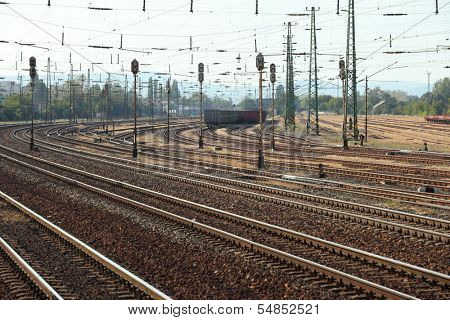 Many railway tracks with freight wagons