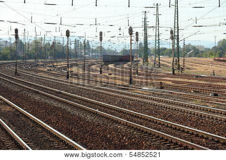 Many railway tracks with freight wagons