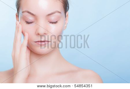 Portrait Blond Girl In Facial Mask On Blue. Beauty Skin Care.