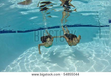 Friends Swimming Underwater