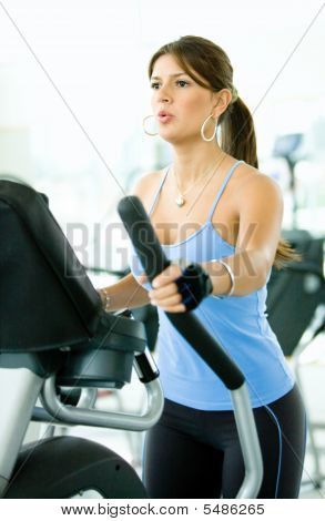 Girl Exercising At The Gym