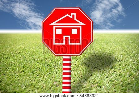 Red Labels With Home Picture On Grass And Blue Sky.