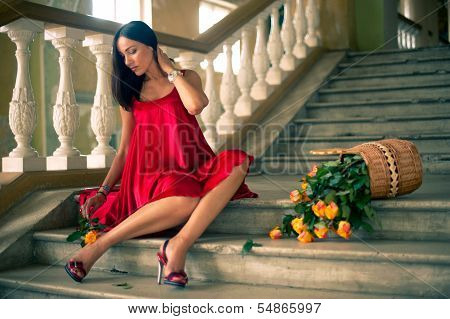 Soft Focus Image Of Beautyful Woman Sitting On Stairs