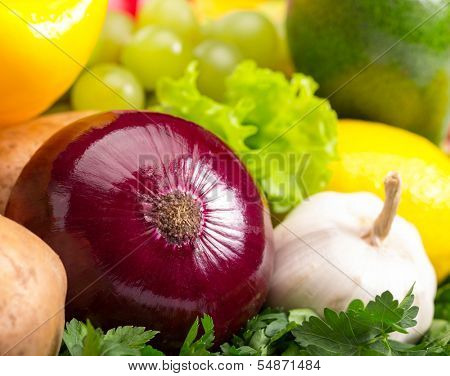 Red onion and white garlic. Close-up photo. Fresh vegetables.