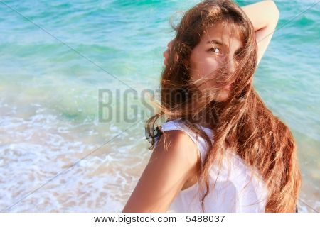 Portrait Of Beautiful Girl On Sea Background