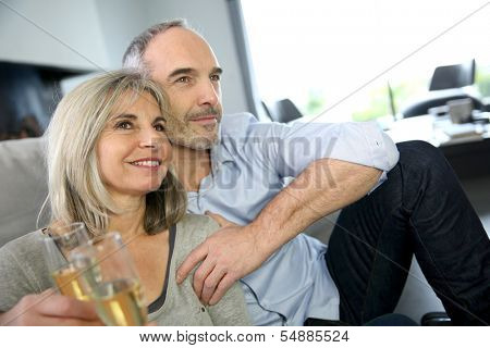 Senior couple celebrating with glass of champaign