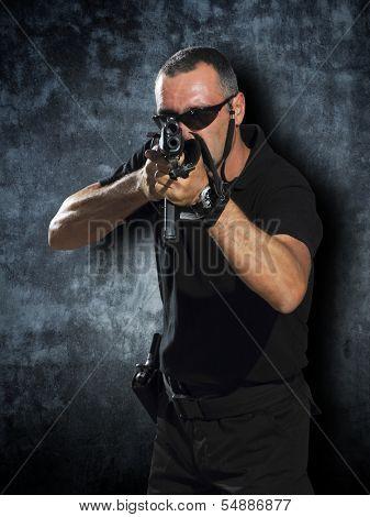 Man shooting with the big guns