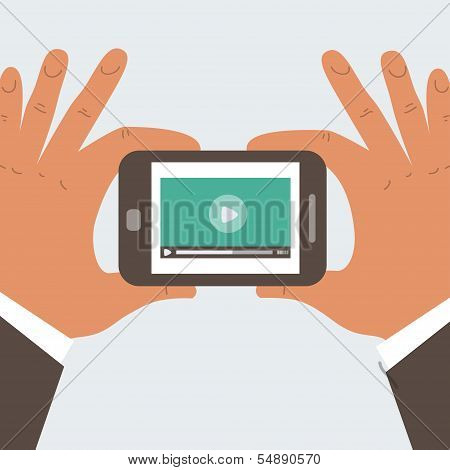 Mobile Phone With Video Player On The Screen In The Human Hands