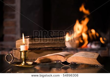 Bible With A Burning Candle