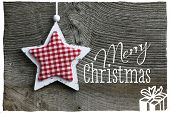 pic of elm  - Merry Christmas message handmade decoration Shabby Chic wooden star with gingham fabric pattern over rustic Elm wood background  - JPG