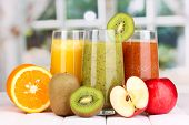 stock photo of juices  - fresh fruit juices on wooden table - JPG