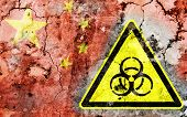 image of biohazard symbol  - Old cracked wall with biohazard warning sign and painted flag flag of China - JPG