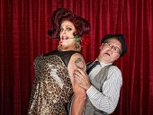 image of drag-queen  - Tall drag queen with rose in mouth and friend - JPG