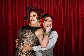 image of drag-queen  - Happy man in drag with smiling businessman - JPG