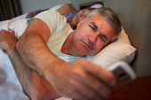 picture of early 50s  - Couple In Bed With Husband Suffering From Insomnia - JPG
