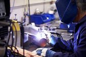 foto of tig  - Factory Engineer Operating TIG Welding Machine - JPG