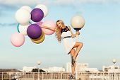 stock photo of balloon  - Happy young girl with big colorful latex balloons - JPG