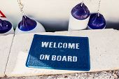 stock photo of coir  - Welcome aboard mat on yacht in marina - JPG