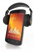 picture of headgear  - Modern headphones on musical smartphone - JPG