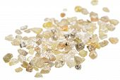 stock photo of uncut  - A pile of raw uncut natural diamonds on white - JPG