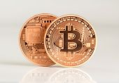 stock photo of golden coin  - one or more bitcoins - JPG