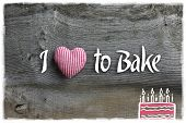 picture of elm  - Love to bake message handmade decoration red stripes fabric hearth over rustic Elm wood background  - JPG