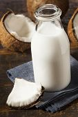 stock photo of coco  - Fresh Organic Coconut Milk in a Bottle - JPG