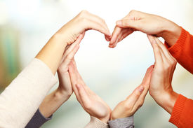 picture of stability  - Human hands in heart shape on bright background - JPG