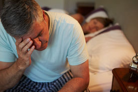 picture of early 50s  - Man Awake In Bed Suffering With Insomnia - JPG