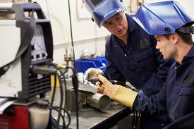 picture of tig  - Engineer Teaching Apprentice To Use TIG Welding Machine - JPG