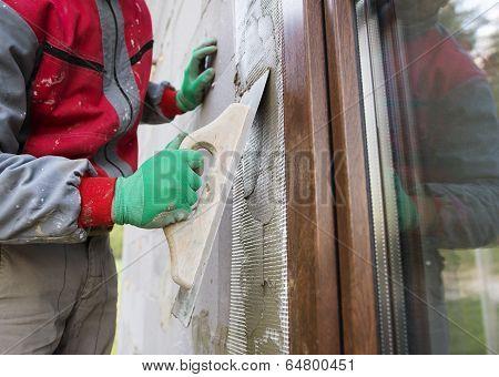 Man plastering