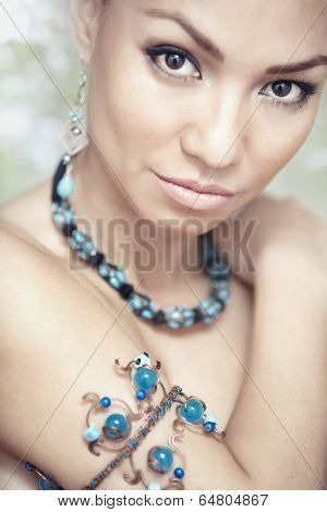Woman With Blue Jewelry