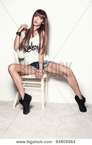 Fashionable Brunette Woman Posing.