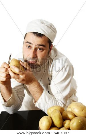 Chef Peeling Potatoes