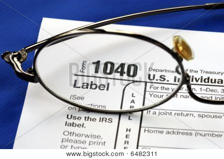Focus on the United States Income Tax 1040, isolated on blue background