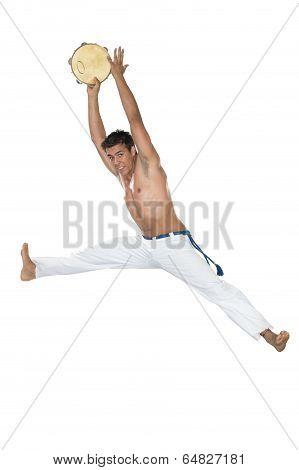 Capoeira, Brazilian Man jumping with tambourine