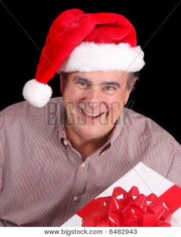 Older Man In Santa Hat With Present