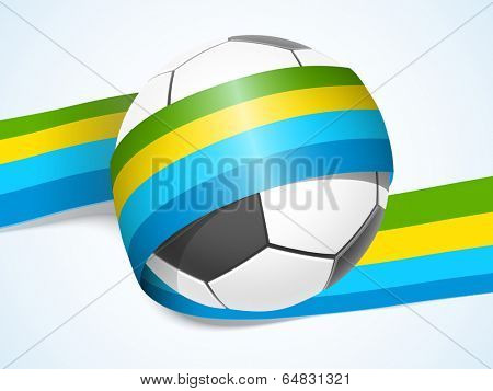 Shiny soccer ball wrapped in colourful stripes on blue background.