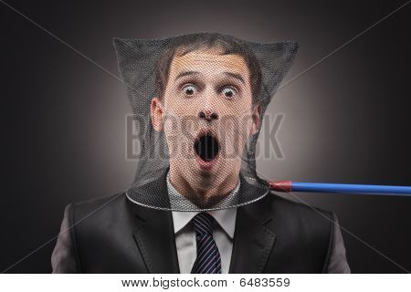 Young man trapped in a butterfly net