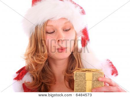 Amazed Miss Santa Is Holding A Golden Gift Box