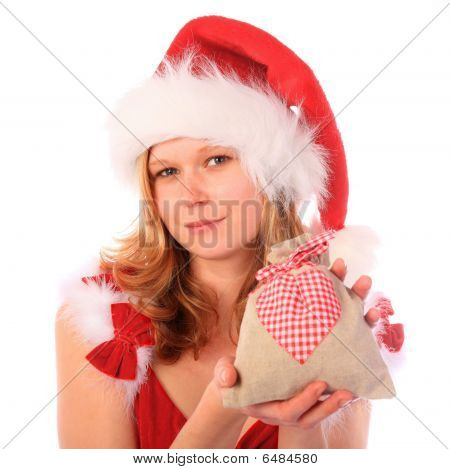Miss Santa Is Holding An Fancy Gift Bag