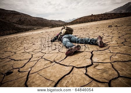 traveler lays on the dried ground