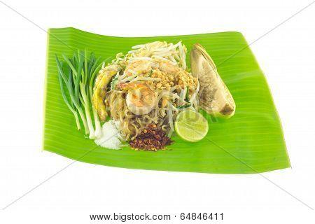 Pad thai on banana leaf isolated on white background