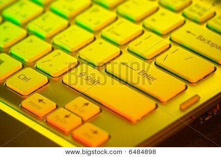 Keyboard of an open notebook. Closeup